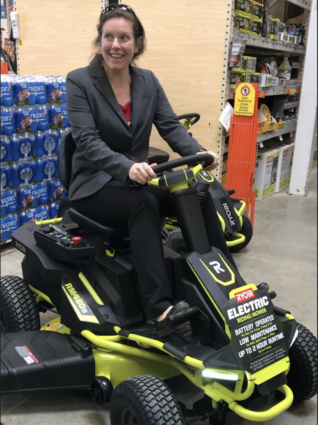 At Home Depot, Test-driving electric lawn mower